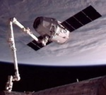 Dragon grappled by ISS on COTS C2+ mission (NASA)